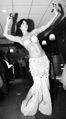 Belly dancer in a restaurant.
